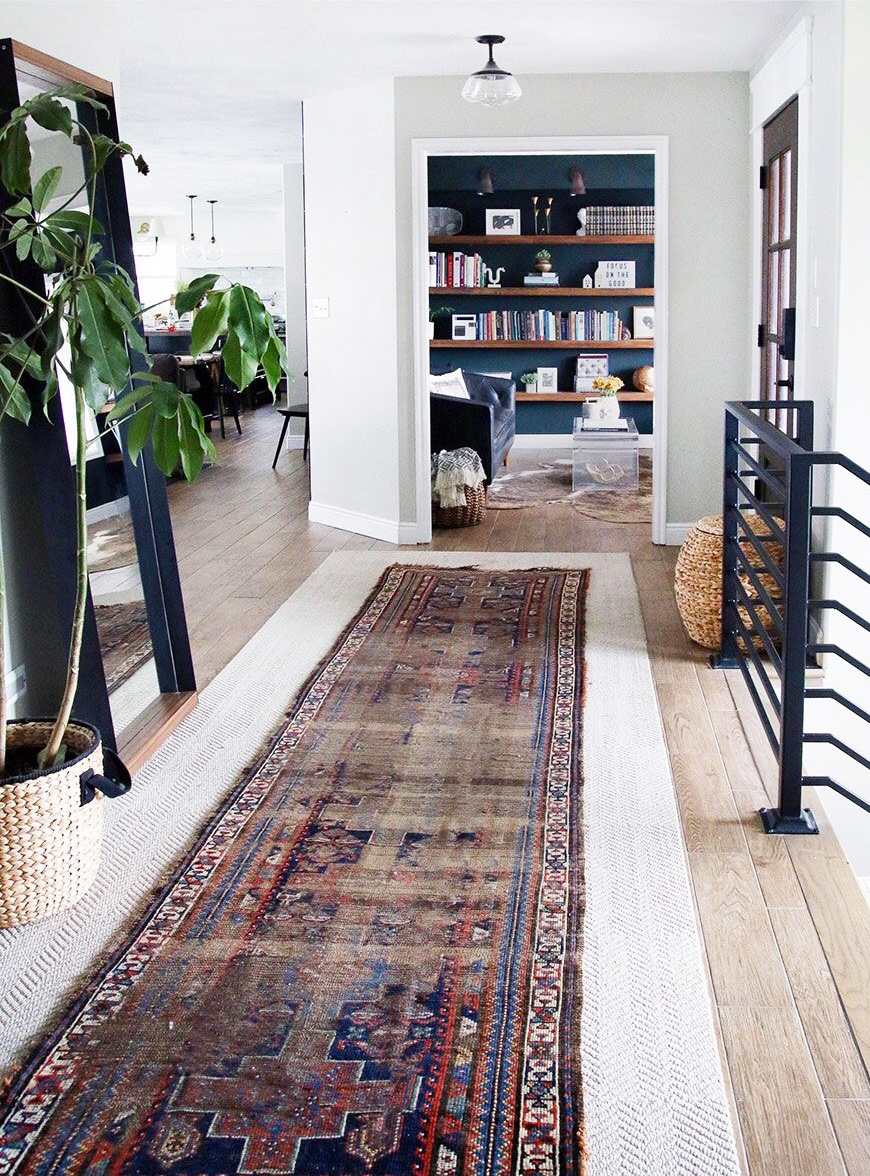 runner rug layered in a hallway
