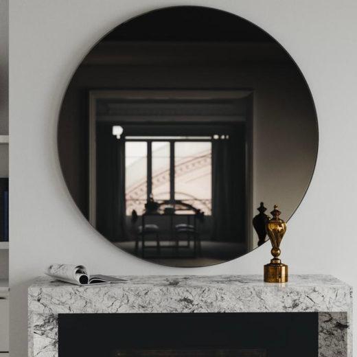 smoked glass mirror above fireplace
