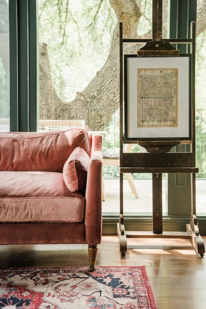 pink velvet couch and antique easel