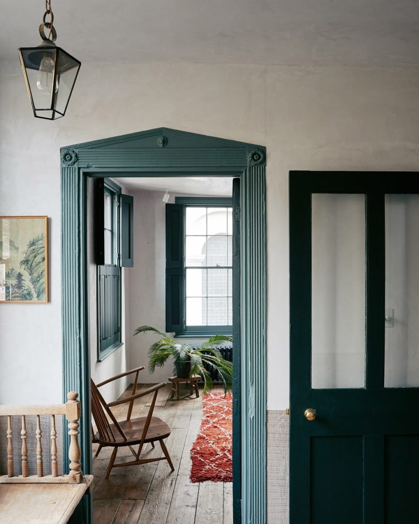 The hallway with green paint door framing